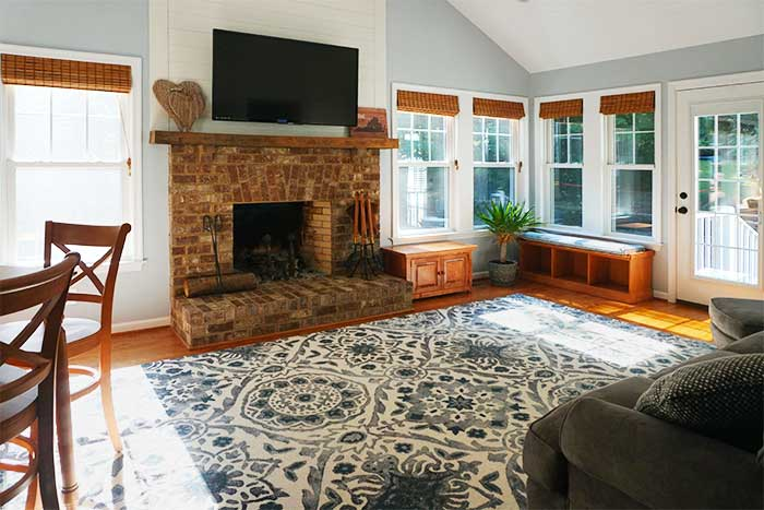 Family room addition with masonry fireplace and ship-lap walls in Appomattox, Virginia