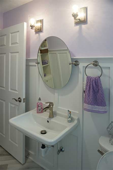 Mirror and bath accessories along with high wainscoting