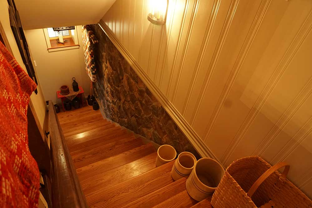 Custom stone and wood paneling in stairwell