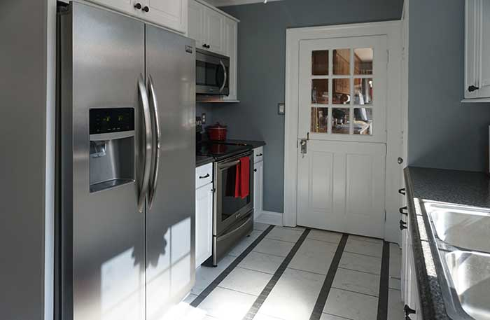 Lynchburg Area Kitchen Remodel with Bright new cabinetry, tile floors, and appliances from Appomattox
